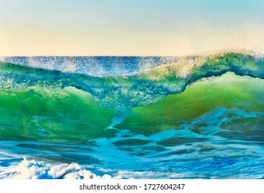 Aqua rolling wave heading to Turimetta beach of Sydney Northern beaches at sunrise.