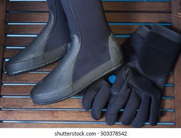 Aqua shoes and gloves. Diving equipment