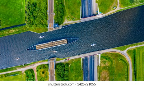 aquaduct in the nederlands, rotated railway. boats on the aqueduct, road underneath