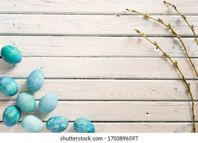 Aquamarine marble Easter eggs lie on a white background. as a symbol of Easter