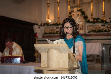 Aquara, Salerno, Italy - June 24, 2019: Prayer of the faithful, the witness of the groom during the liturgy. Wedding day