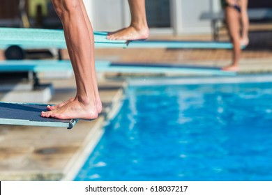 Aquatic Diving Feet Boards Pool Closeup Aquatic diving pool divers feet edge of board for backflip into swimming pool abstract closeup unidentified athletes.