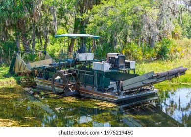 Aquatic weed harvester - Cooter Pond Park, Inverness, Florida, USA