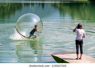 Aquazorbing. Aqua zorbing on water. Hrabovo, Ruzomberok
