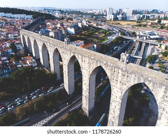 "The Aqueduct Aguas Livres (in Portuguese: Aqueduto das Aguas Livres ""Aqueduct of the Free Waters"") is a historic aqueduct in the city of Lisbon, Portugal, summer sunny view, shot from drone"