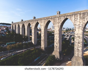 """The Aqueduct Aguas Livres (in Portuguese: Aqueduto das Aguas Livres """"Aqueduct of the Free Waters"""") is a historic aqueduct in the city of Lisbon, Portugal, summer sunny view, shot from drone"""