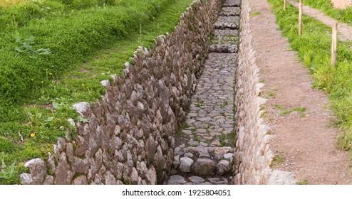 Aqueduct with inca stoneworks in cusco, peru.