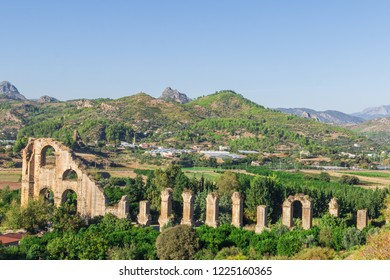 Aqueducts in the ancient city of Aspendos in Antalya, Turkey. Beautiful view with mountains in the background.