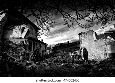 Aquila, Italy 17 april 2009: A boy looks at the destroyed city by  earthquake that hit central Italy during the L'Aquila earthquake in April 2009.