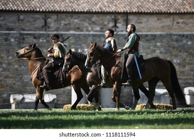 Aquileia, Italy - 17 June 2018: Three Celtic nights in traditional costumes ride horses during Tempora in Aquileia, ancient Roman historical re-enactment