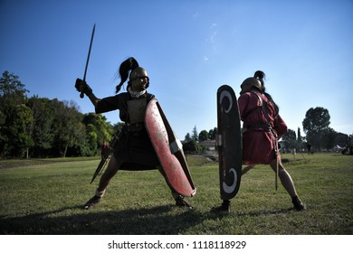 Aquileia, Italy - 17 June 2018: Roman Legionaries with shields, helmets and gladius swords, fight during Tempora in Aquileia, ancient Roman historical re-enactment