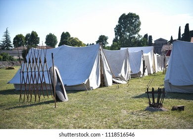 Aquileia, Italy - 17 June 2018: Roman legionary camp with tent, shileds, helmets and army insignia during the Tempora in Aquileia, ancient Roman historical re-enactment