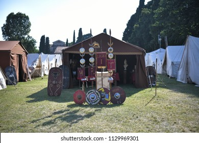 Aquileia, Italy - 17 June 2018: Roman legionary camp with tents, shields and the army insignia during the Tempora in Aquileia, ancient Roman historical re-enactment