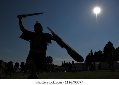 Aquileia, Italy - 17th June, 2018. An ancient Roman legionary fights with sword and shield during Tempora in Aquileia, ancient Roman historical re-enactment