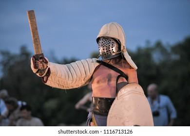 Aquileia, Italy. 17th June, 2018. A Gladiator wearing a traditional Ancient Roman costume poses with helmet shield and sword before a battle during Tempora in Aquileia, ancient Roman historical re-ena