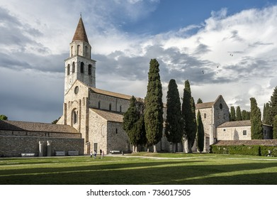 AQUILEIA, ITALY,  APRIL 26, 2014: Unidentified tourist visiting the Archaeological Area and the Patriarchal Basilica of Aquileia.