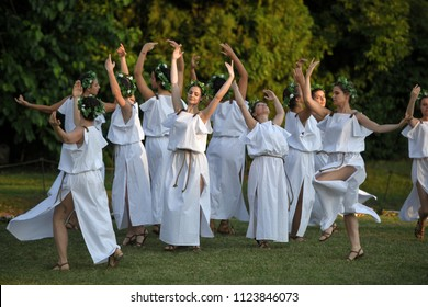 Aquileia, Italy - June 17, 2018: Dancers in traditional ancient roman costumes dance during Tempora in Aquileia, ancient Roman historical re-enactment