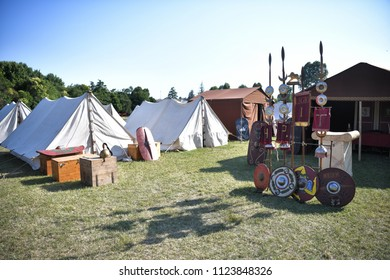 Aquileia, Italy - June 17, 2018: Roman legionary camp with tents, shields, helmets and army insignia during the Tempora in Aquileia, ancient Roman historical re-enactment