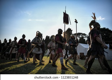 Aquileia, Italy - June 17, 2018: Ancient roman legionaries march holding the army insignia during Tempora in Aquileia, ancient Roman historical re-enactment