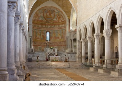 AQUILEIA, Italy - November 11, 2013: Central nave of the Basilica of Aquileia, Italy, with its beautiful ancient mosaic floor, the biggest and one of the most important of the Western Christianity.
