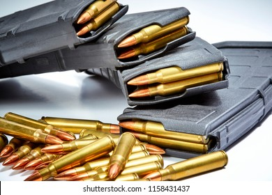 AR 15 full metal jacket ammunition with magazines loaded isolated on white