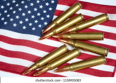 AR 15 full metal jacket ammunition laying on an American Flag