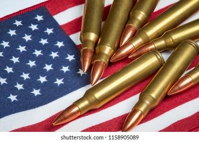 AR 15 full metal jacket ammunition laying on an American Flag