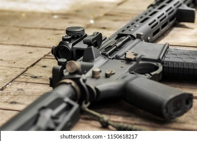 Ar15 automatic assault rifle weapon with aim sight and flashlight