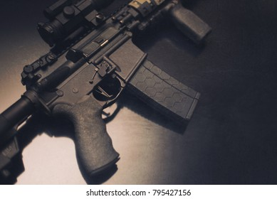 AR-15 closeup of trigger and grip on glass