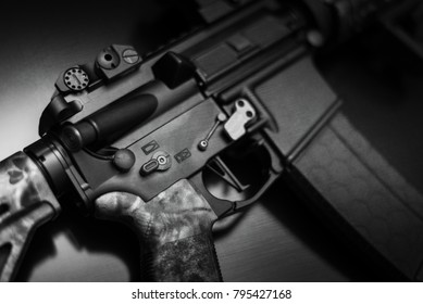 AR-15 closeup of trigger on glass