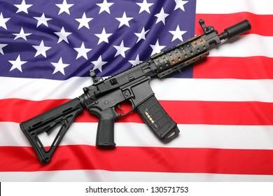AR-15 (M4A1) custom carbine on the flag of USA