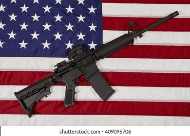 AR15 M4A1 M16 Style Weapon Automatic Rifle on USA Flag concept freedom justice liberty patriotism