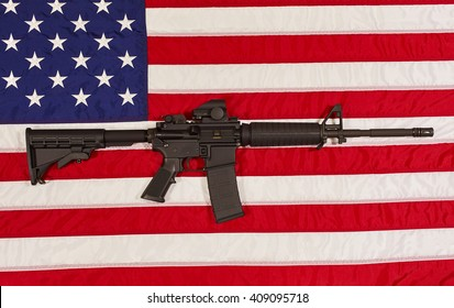 AR15 M4A1 M16 Style Weapon Automatic Rifle with USA Flag concept freedom justice patriotism