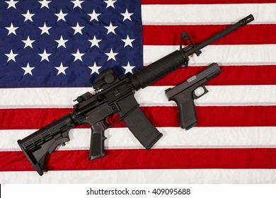AR15 M4A1 Style Weapon Automatic Rifle and Pistol on USA Flag concept freedom and justice