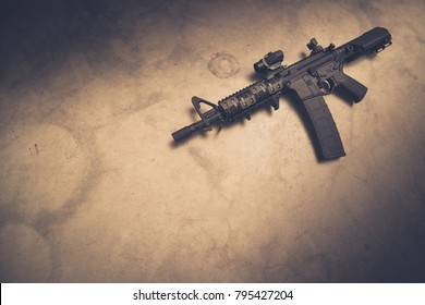 AR-15 pistol on concrete with title space