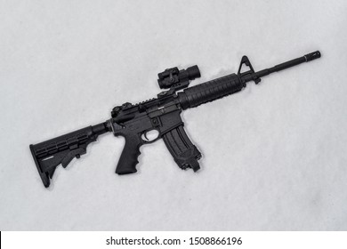 AR15 with red dot laying in snow