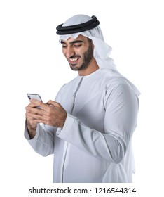 Arab bearded businessman can`t stop laughing as reading sms or jokes, isolated over white background. Overjoyed hipster Emirati guy, uses modern smart phone.