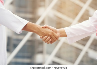 Arab business shake hands showing Trustworthy team work .Collaborative Business Group Collaboration Expresses Confidence in Meetings, Mergers, Expansion, Growth and Good Return in the Future, Business