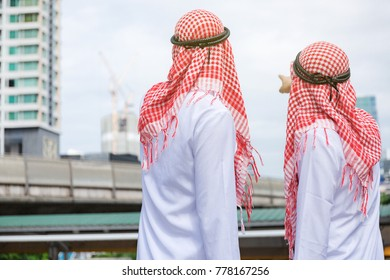 Arab business talking to destinations in work.