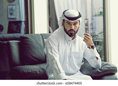 Arab Businessman facing the Camera (Wearing Qatari Traditional Dress)