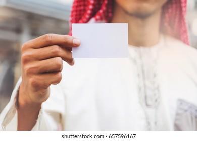 Arab Businessman hand showing business card