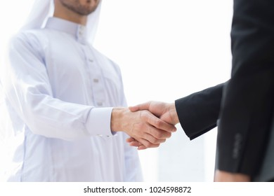 Arab businessman handshake with partnership ,The Leader , Positive Work Keys to Successful Business Operation, Business city success industry.