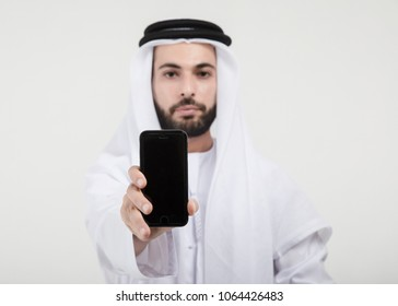 Arab Businessman holding and showing the mobile phone, Arab business concpet