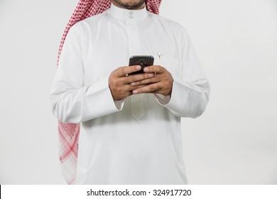 Arab businessman messaging on mobile