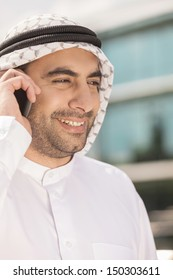 Arab businessman on the phone. Cheerful Arab businessman talking on the mobile phone and smiling