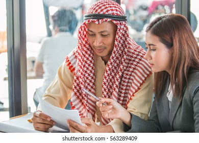 Arab businessman talking and presentation with engineer or co-worker.