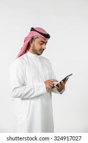 Arab businessman using digital tablet