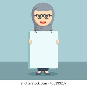 arab businesswoman holding a poster advertising boards