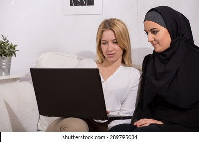 Arab and caucasian women surfing on the internet