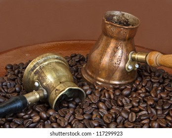Arab coffee pots and roasted coffee beans
